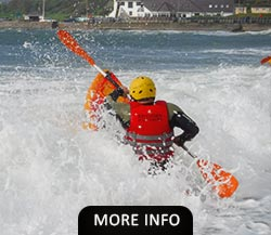 Man paddling a Kayaking into the sea waves